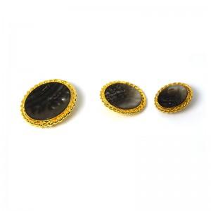 bottone gioiello madreperla con contorno filigranata dorata